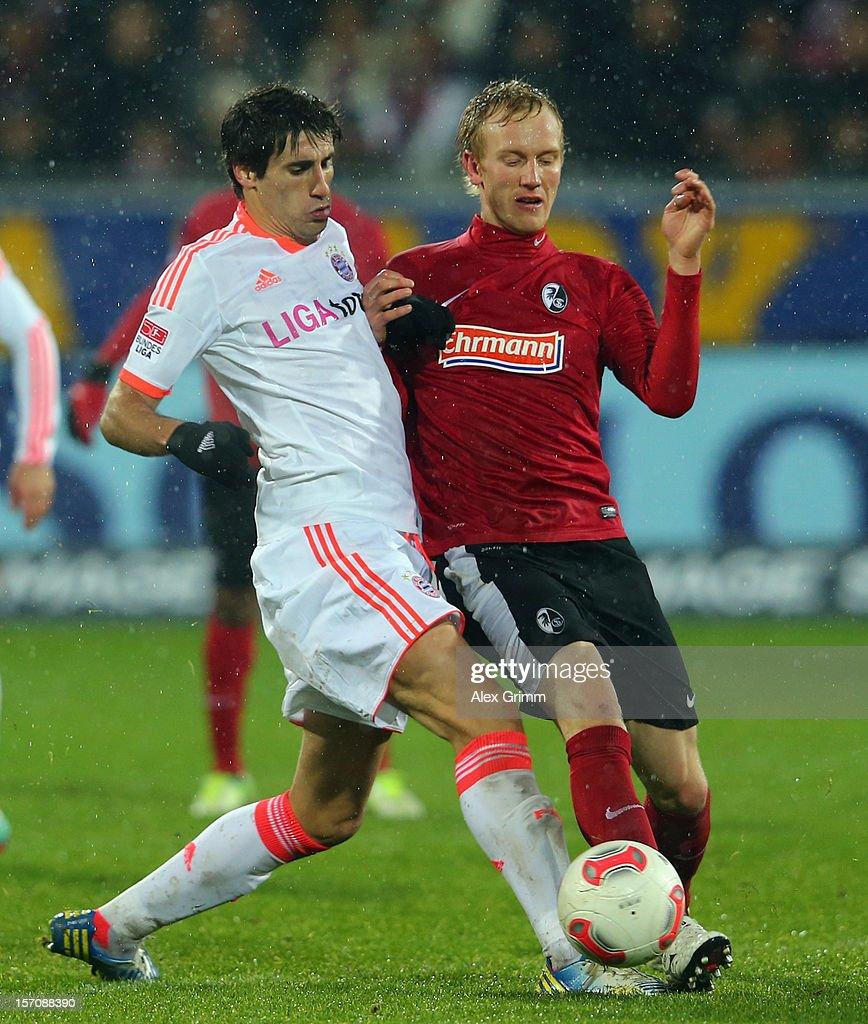 Jan Rosenthal (R) of Freiburg is challenged by Javier Martinez of Muenchen during the Bundesliga match between SC Freiburg and FC Bayern Muenchen at MAGE SOLAR Stadium on November 28, 2012 in Freiburg im Breisgau, Germany.