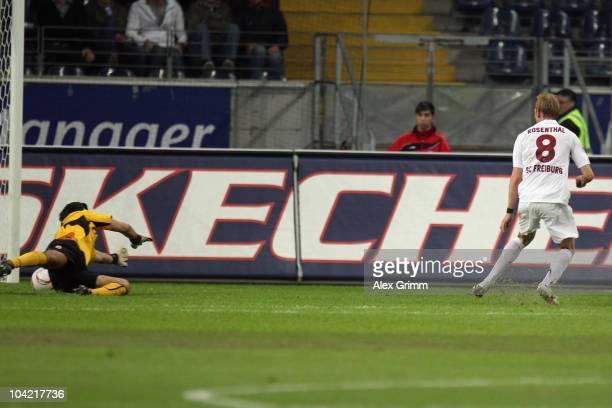 Jan Rosenthal of Freiburg scores his team's first goal against goalkeeper Oka Nikolov of Frankfurt during the Bundesliga match between Eintracht...