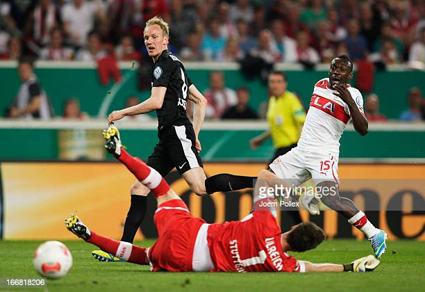 Jan Rosenthal of Freiburg scores his team's first goal during the DFB Cup Semi Final match between VfB Stuttgart and SC Freiburg at Mercedes-Benz...