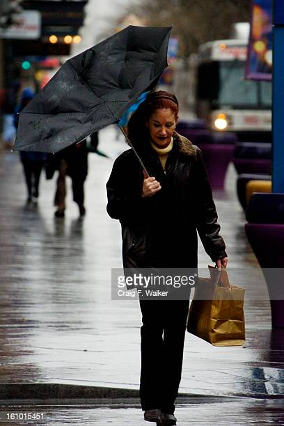 Jan Rubin owner of KenmarkShaw's Fine Jewelers at 612 16th Street makes her way to the Post Office passing through the cold wind snow and rain on the...