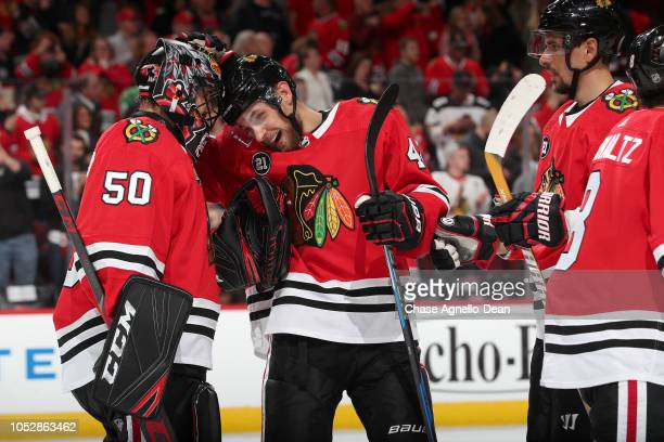 Jan Rutta and goalie Corey Crawford of the Chicago Blackhawks celebrate after defeating the Anaheim Ducks 31 at the United Center on October 23 2018...