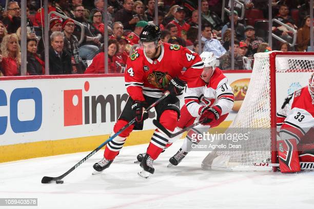 Jan Rutta of the Chicago Blackhawks approaches the puck ahead of Andrei Svechnikov of the Carolina Hurricanes in the second period at the United...