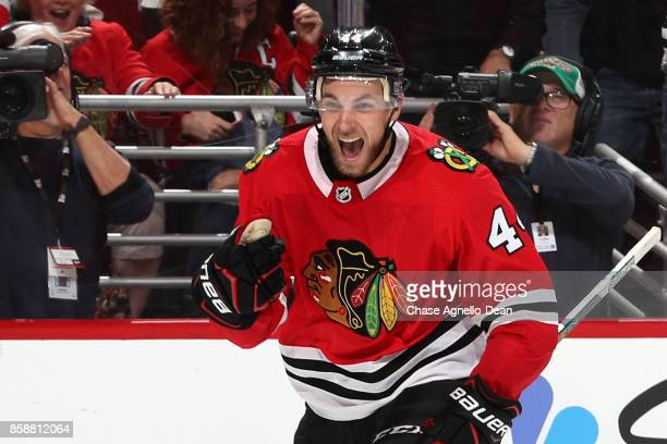 Jan Rutta of the Chicago Blackhawks celebrates after scoring his first NHL career goal in the second period against the Columbus Blue Jackets at the...