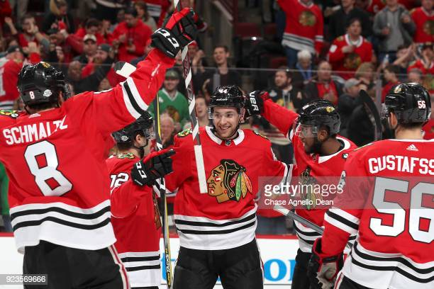 Jan Rutta of the Chicago Blackhawks celebrates with teammates after scoring against the San Jose Sharks in the second period at the United Center on...