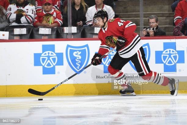 Jan Rutta of the Chicago Blackhawks chases the puck in the second period against the San Jose Sharks at the United Center on March 26 2018 in Chicago...