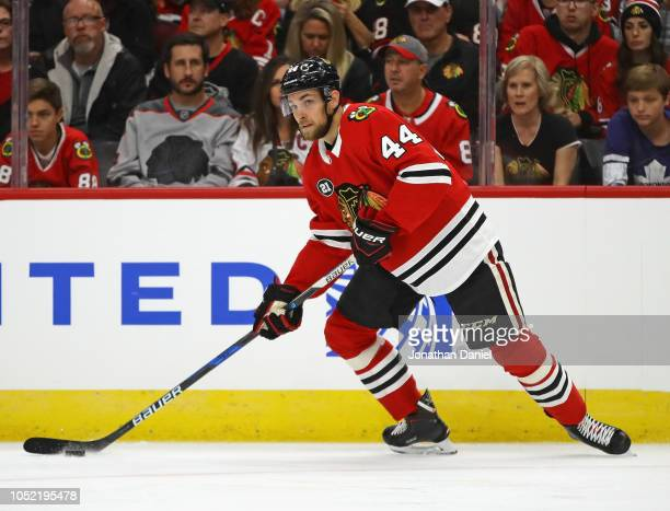 Jan Rutta of the Chicago Blackhawks looks to pass against the Toronto Maple Leafs during the regular season opening home game at the United Center on...