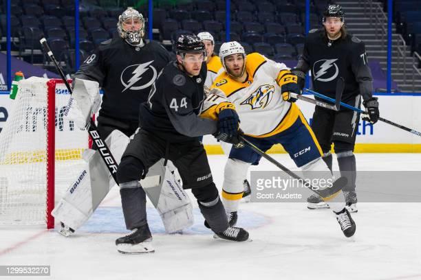 Jan Rutta of the Tampa Bay Lightning skates against Luke Kunin of the Nashville Predators during the second period at Amalie Arena on January 30,...