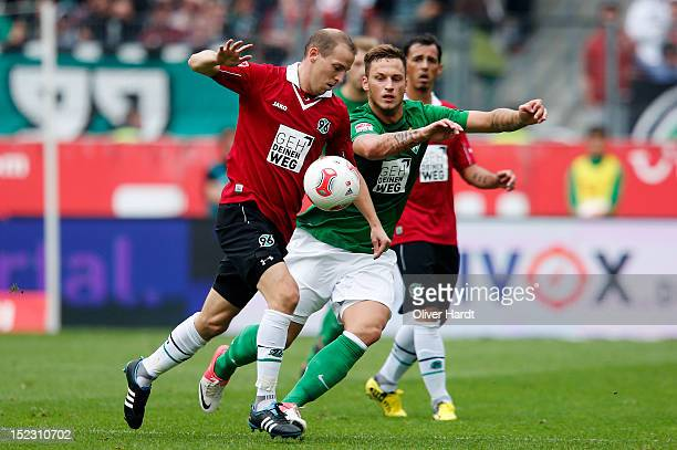 Jan Schlaudraff of Hannover and Marko Arnautovic of Bremen battle for the ball during the 1 Bundesliga match between Hannover 96 and Werder Bremen at...