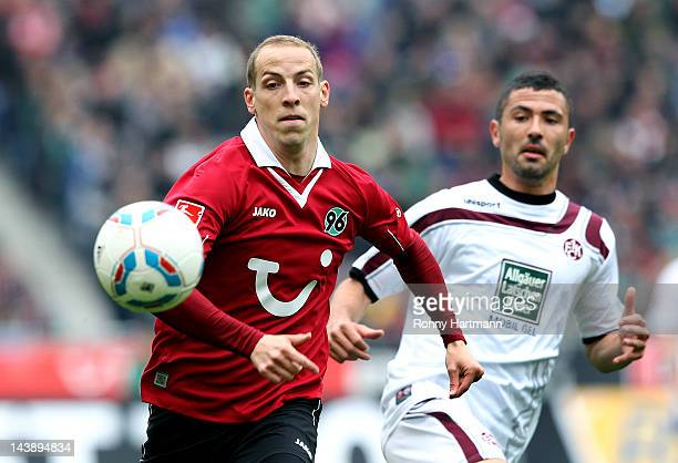 Jan Schlaudraff of Hannover and Olcay Sahan of Kaiserslautern compete for the ball during the Bundesliga match between Hannover 96 and 1. FC...