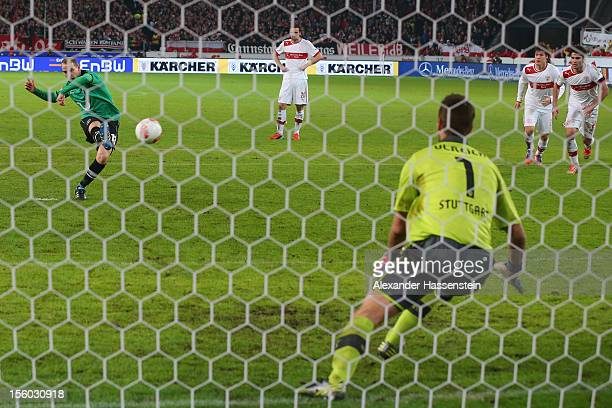 Jan Schlaudraff of Hannover scores the 2nd team goal witha penalty kick against Sven Ulreich keeper of Stuttgart during the Bundesliga match between...