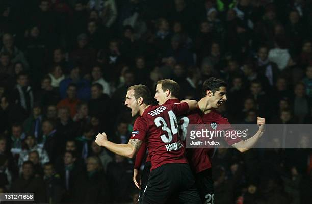 Jan Schlaudraff of Hannovercelebrates with his team mates after scoring his team's first goal during the UEFA Europa League Group B match between FC...