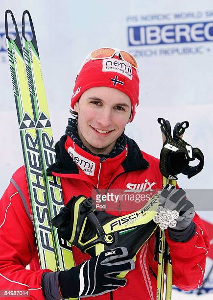 Jan Schmid of Norway poses with the Silver medal he won during the Cross Country 10KM competition of the Nordic Combined Individual event at the FIS...