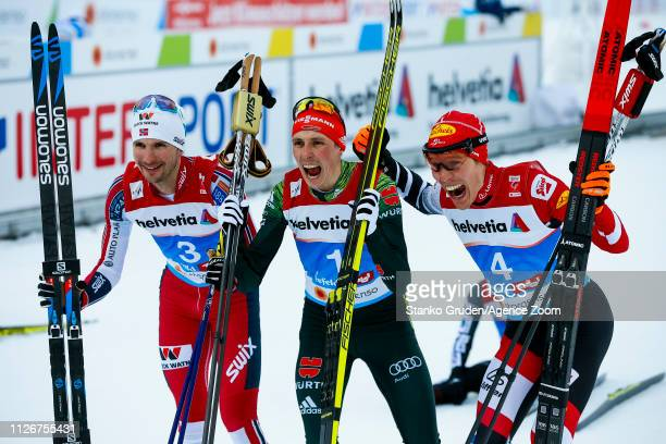 Jan Schmid of Norway takes 2nd place, Eric Frenzel of Germany takes 1st place, Franz-josef Rehrl of Austria takes 3rd place during the FIS Nordic...