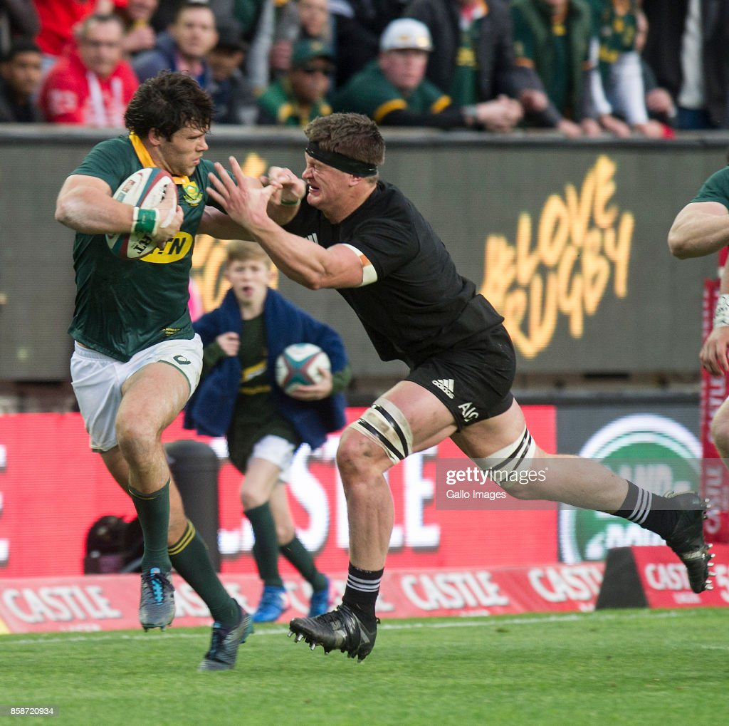 Jan Serfontein of South Africa tries to hand off Sam Whitelock of New Zealand during the Rugby Championship 2017 match between South Africa and New Zealand at DHL Newlands on October 07, 2017 in Cape Town, South Africa.