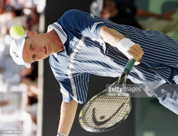 Jan Siemerink of the Netherlands returns a backhand 06 April against Andre Agassi of the US during their Davis Cup match at Newport Beach California...