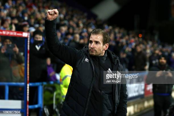 Jan Siewert Manager of Huddersfield Town acknowledges the fans prior to the Premier League match between Huddersfield Town and Everton at John...