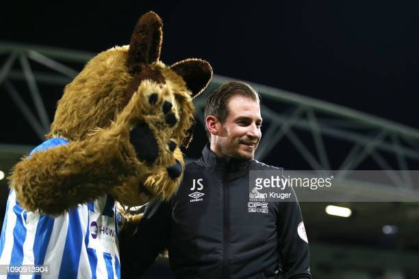 Jan Siewert Manager of Huddersfield Town speaks to the mascot prior to the Premier League match between Huddersfield Town and Everton at John Smith's...