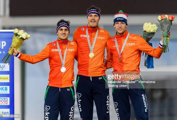 Jan Smeekens of the Netherlands Hein Otterspeer of the Netherlands and Ronald Mulder of the Netherlands stand on the podium after the Men's 500m...