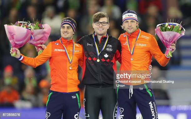 Jan Smeekens of the Netherlands poses during the medal ceremony after winning the 2nd place Laurent Dubreuil of Canada poses during the medal...