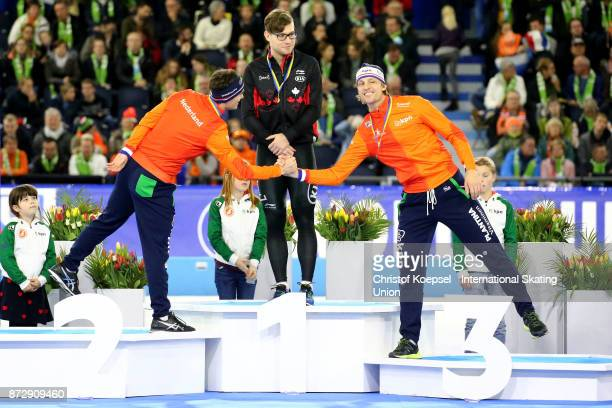 Jan Smeekens of the Netherlands won the second place and congratulates Ronald Mulder of the Netherlands 2who won the third place In the middle winner...