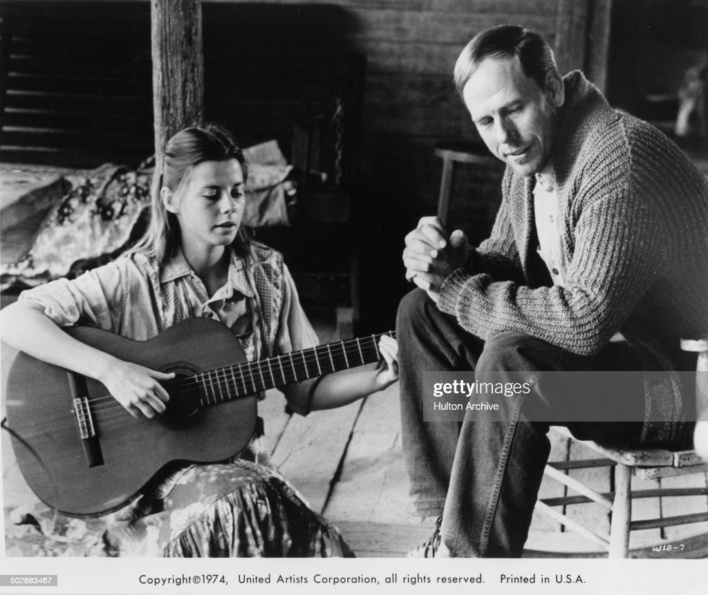 Jan Smithers signs with her father Rance Howard in a scene for the United Artist movie 'Where the Lilies Bloom' circa 1974.