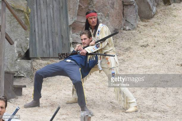 Jan Sosniok and a background artist attend the Karl May play 'Old Surehand' press rehearsal on June 16 2017 in Bad Segeberg Germany