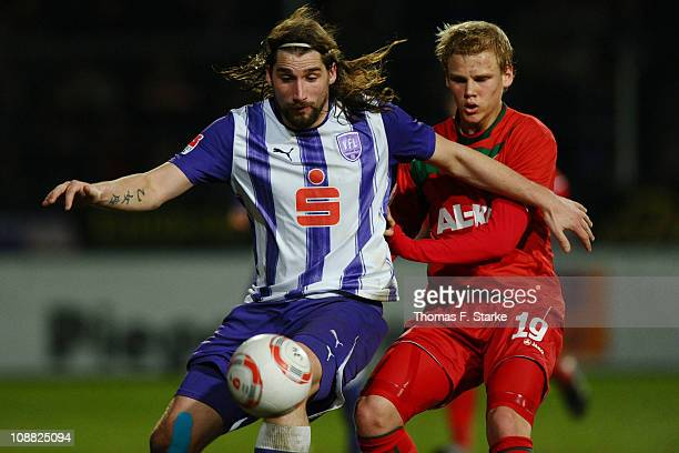 Jan Tauer of Osnabrueck and Soeren Bertram of Augsburg fight for the ball during the Second Bundesliga match between VfL Osnabrueck and FC Augsburg...