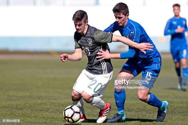 Jan Thielmann of Germany U16 challenges Lorenzo Pirola of Italy U16 during UEFA Development Tournament match between U16 Italy and U16 Germany at...