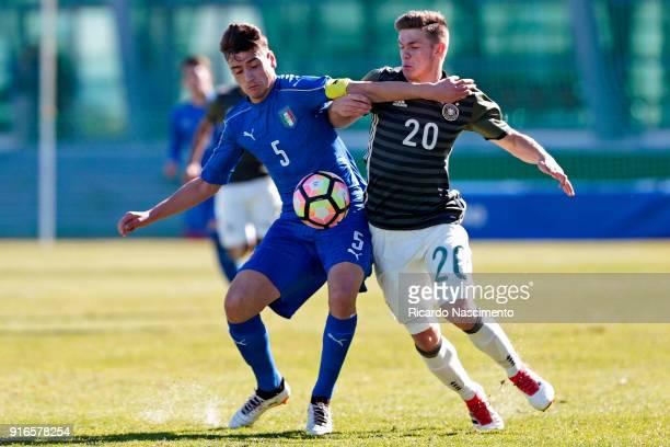 Jan Thielmann of Germany U16 challenges Raffaele Spina of Italy U16 during UEFA Development Tournament match between U16 Italy and U16 Germany at...