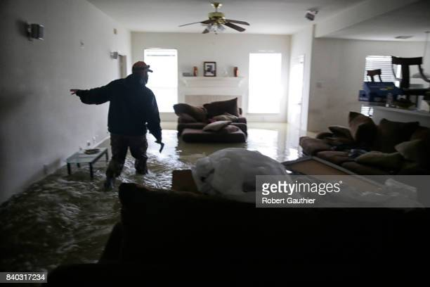 Jan Tullos searches an empty home for an injured woman who was reportedly stranded inside her Twin Oaks Village in Clodine The home was empty Tullos...