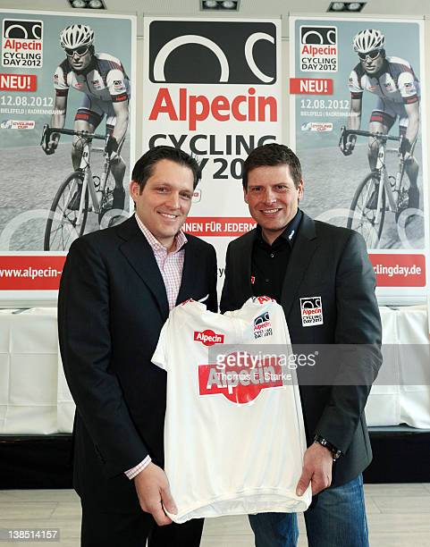 Jan Ullrich and Eduard R Doerrenberg acting partner of Dr Kurt Wolff GmbH Co KG pose for photographers during the press conference of Alpecin at the...