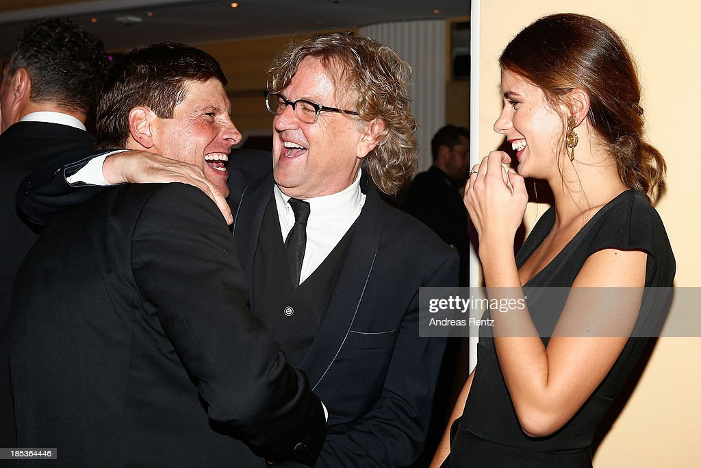 Jan Ullrich, Martin Krug and partner Julia Trainer attend the 7th Audi Generation Award 2013 at Hotel Bayerischer Hof on October 19, 2013 in Munich, Germany.