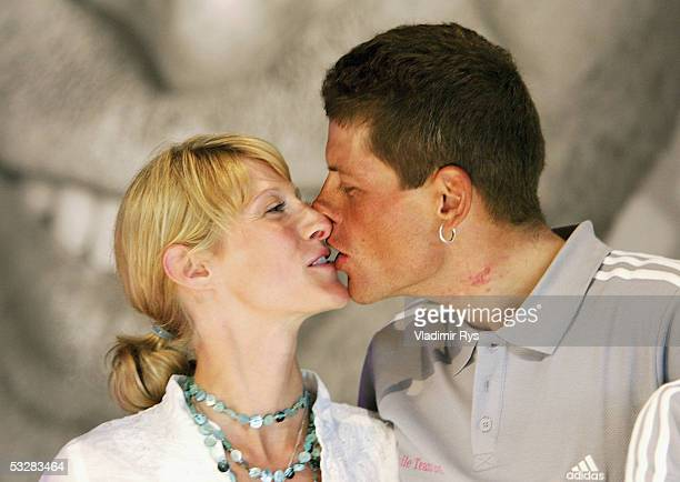 Jan Ullrich of Germany kisses his girlfriend Sara Steinhauser during the arrival of the TMobile cycling team after the completion of the Tour de...