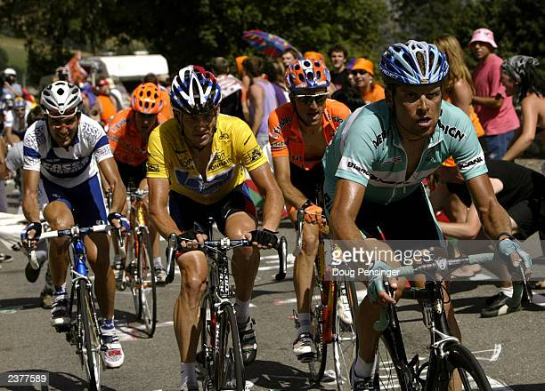 Jan Ullrich of Germany, riding for Team Bianchi , leads Lance Armstrong of the United States, riding for US Postal-Berry Floor , during stage 14 of...