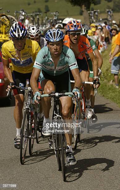 Jan Ullrich of Germany, riding for Team Bianchi, leads Lance Armstrong of the United States, riding for US Postal-Berry Floor, and Haimer Zubeldia of...