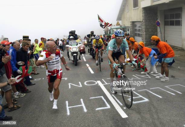 Jan Ullrich of Germany riding for Team Bianchi leads Lance Armstrong of the USA riding for the US Postal-Berry Floor team during the climb leading to...