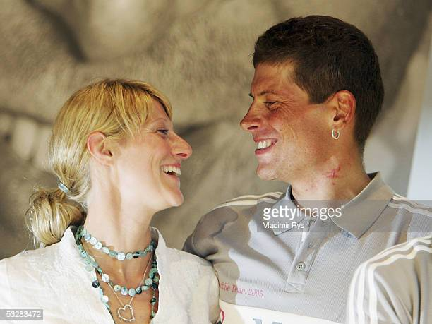 Jan Ullrich of Germany smiles at his girlfriend Sara Steinhauser during the arrival of the TMobile cycling team after the completion of the Tour de...