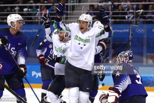 Jan Urbas of Slovenia celebrates a goal scored by Blaz Gregorc against Ryan Zapolski of the United States in the third period during the Men's Ice...