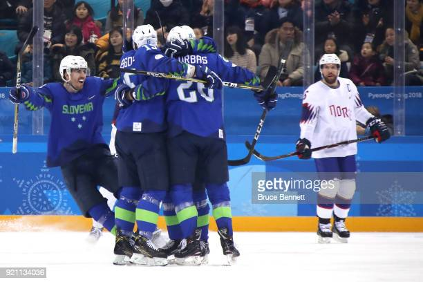 Jan Urbas of Slovenia celebrates with his teammates after scoring a goal against Lars Haugen of Norway in the first period during the Men's Play-offs...