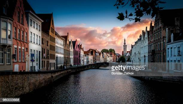 jan van eyckplein at sunset, bruges, belgium - bruges stock pictures, royalty-free photos & images