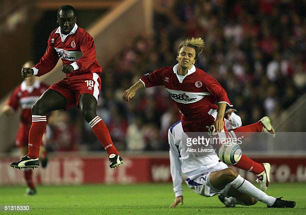 Jan Velkoborsky of Banik Ostrava brings down Bolo Zenden of Middlesbrough as team mate Jimmy Floyd Hasselbaink takes evasive action during the UEFA...