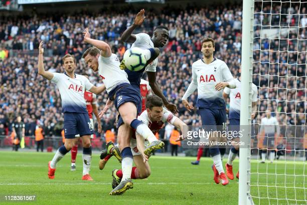Jan Vertonghen and Davinson Sanchez of Tottenham and Laurent Koscielny of Arsenal collide as they all go up for the ball during the Premier League...