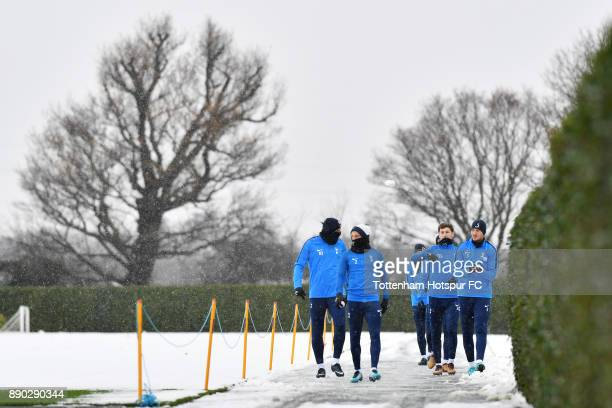 Jan Vertonghen Ben Davies Kieran Trippier and Harry Kane of Tottenham Hotspur throw snowballs during a Tottenham Hotspur Training Session on December...