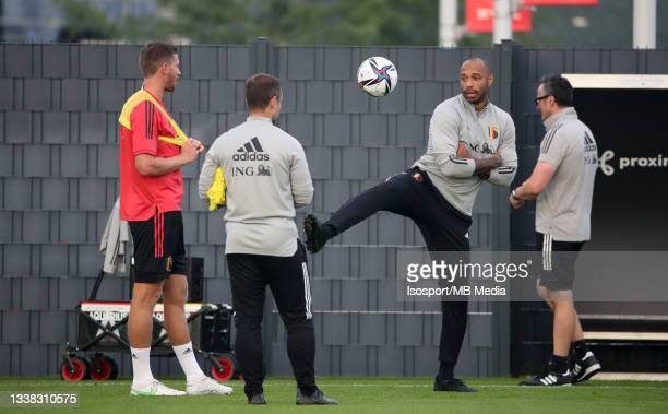 """Jan Vertonghen of Belgium and Thierry Henry, assistant coach of Belgium, during a training session of the Belgian national soccer team """" The Red..."""