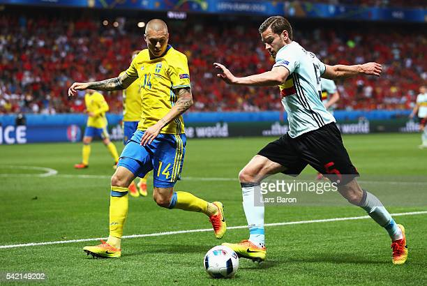 Jan Vertonghen of Belgium crosses under pressure from Victor Lindelof of Sweden during the UEFA EURO 2016 Group E match between Sweden and Belgium at...