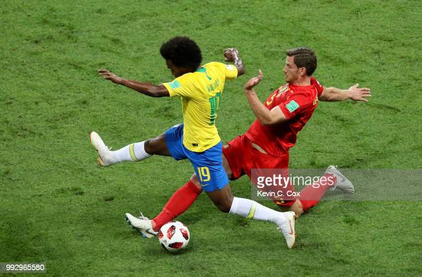Jan Vertonghen of Belgium tackles Willian of Brazil during the 2018 FIFA World Cup Russia Quarter Final match between Brazil and Belgium at Kazan...