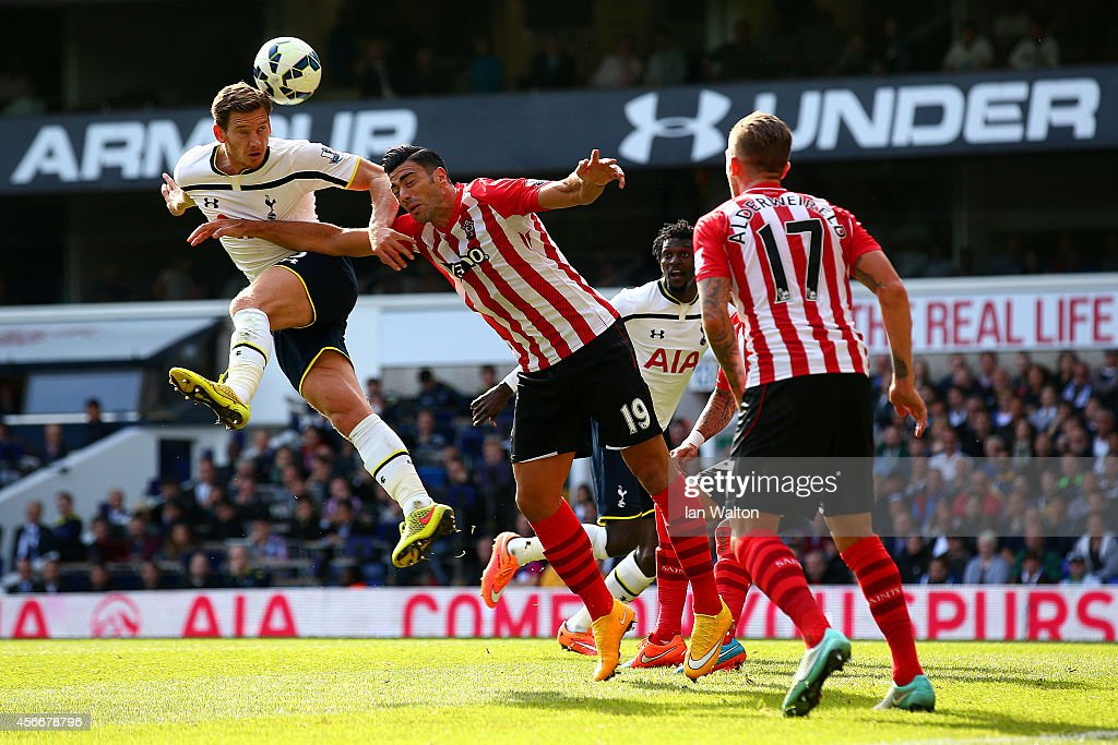 Jan Vertonghen of Spurs heads towards goal under pressure from Graziano Pelle of Southampton during the Barclays Premier League match between Tottenham Hotspur and Southampton at White Hart Lane on October 5, 2014 in London, England.