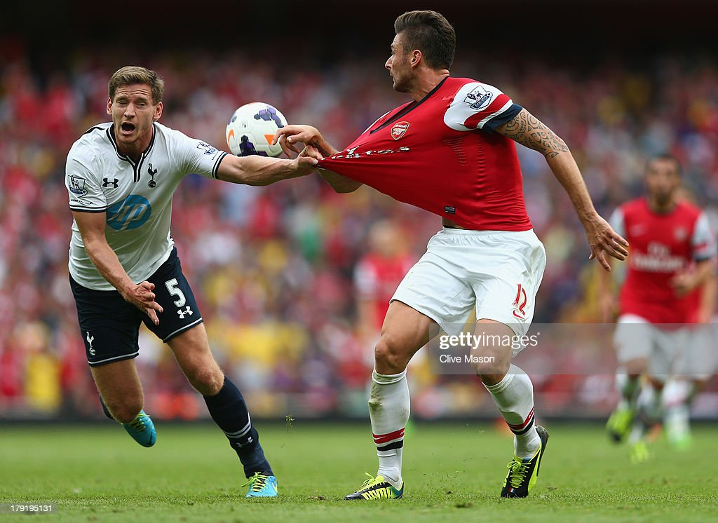 Jan Vertonghen of Spurs pulls on the shirt of Olivier Giroud of Arsenal during the Barclays Premier League match between Arsenal and Tottenham Hotspur at Emirates Stadium on September 01, 2013 in London, England.
