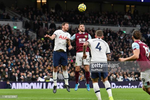Jan Vertonghen of Tottenham contests a header with Robbie Brady of Burnley during the Premier League match between Tottenham Hotspur and Burnley at...
