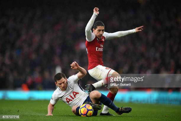 Jan Vertonghen of Tottenham Hotspur and Hector Bellerin of Arsenal in action during the Premier League match between Arsenal and Tottenham Hotspur at...